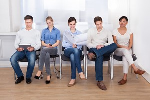 Group Of People Sitting On Chair In A Waiting Room